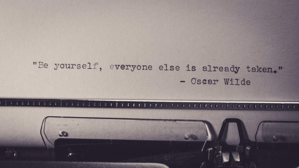 An Oscar Wilde quote showing capitlization in quotes